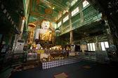 The seated Buddha presiding in Soon U Pone Nya Shin Paya,Myanmar. — Stock Photo