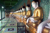 Row of Buddhas in U Min Thonze cave ,Sagaing hill,Myanmar. — Foto de Stock