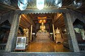 Golden Buddha inside at wood Church of Nyan Shwe Kgua temple in Myanmar. — Stock Photo