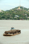 Teak logs in timber on boat in Ayeyarwaddy river,Myanmar. — Stock Photo