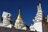 Golden pagoda and lion guardians in temple of Pindaya city , Myanmar. — Stock Photo