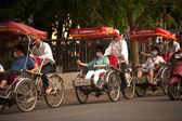 Tourist taking a cycro ride. — Stock Photo