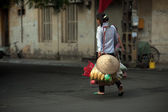 Woman carrying commodity on street in Hanoi,Vietnam. — Stock Photo