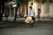 Woman carrying commodity on street in Hanoi,Vietnam. — Stock Photo