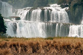 Straw front of Datian waterfall in China. — Stock Photo