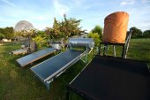 Solar collector tank container for water heating and water. — Stock Photo