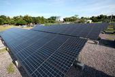 Solar panels in a row on Thailand electric plant . — Photo