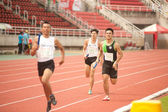 Relay in Thailand Open Athletic Championship 2013. — Stock Photo