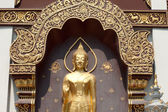 Basrelief golden Buddha on church in Thai temple. — Stock Photo
