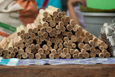 Glutinous rice roasted in bamboo joints. — Stock Photo
