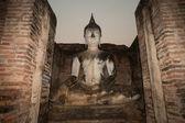 Ancient sitting Buddha in Wat Mahathat temple at Sukhothai Historical Park. — Stock Photo