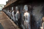 Group of standing ancient buddhas sculpture at pagoda in Wat Mahatat temple. — Stock Photo