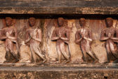 Group of standing ancient buddhas sculpture at pagoda in Wat Mahatat temple. — Stock fotografie