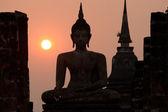 Silhouette of big Sukhothai Buddha in Wat Mahathat temple . — Stock Photo