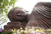 Ancient reclining buddha from India. — Стоковое фото