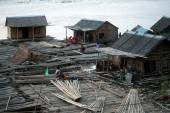 People living bamboo raft. — Stock Photo