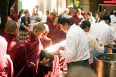 Peoples  giving with  alms to a BUddhist Monk in Myanmar. — Photo