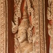 Ancient Laos art wood carving on church in  Hor Phakeo temple in Vientiane city,Laos. — Stock Photo #65617017