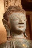 Ancient Buddha on the  Church in Hor Phakeo Temple, Laos . — Stock Photo