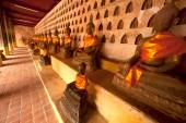 Row of ancient Buddha on the wall of Church in Si Saket Temple. — Stock Photo