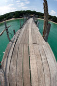 Traditional wooden bridge on the beach. — Stock Photo
