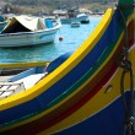 Traditional luzzu boats in Marsaxlokk — Stock Photo #72409815