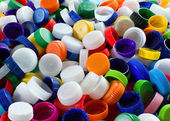 Colorful plastic caps — Stock Photo