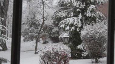 Snowfall Through House Window — Stock Video