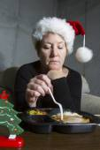 Sad Woman Eating Christmas Dinner Alone — ストック写真