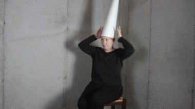 Woman in Dunce Cap Making Faces — Stock Video