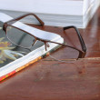 Open book and glasses — Stock Photo #60736005