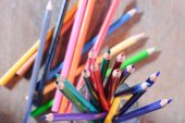Colorful pencils on color wooden background — Stock Photo