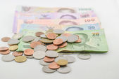 Thai money banknotes and coins — Stock Photo