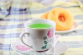Cup of tea with a donut — Stock Photo