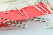 Paper clip and red paper — Stock Photo
