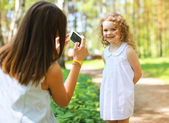 Happy mother and daughter having fun photographed on the smartph — Stock Photo