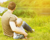 Father and son resting on the nature — Stock Photo