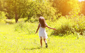 Little girl walks on nature — Stok fotoğraf
