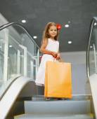 Little girl with shopping bag — Stock Photo