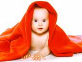 Charming baby crawls in towel — Stok fotoğraf