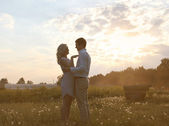 Romantic couple in love summer evening sunset — Stock Photo