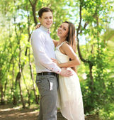 Pretty young couple in love enjoying summer time — Stock Photo