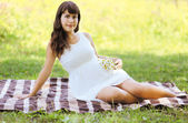 Lovely pregnant woman in summer day — Stock Photo