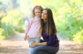 Mother and child walking in park — Stock Photo