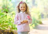 Portrait charming little girl outdoors — Stock Photo