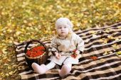 Autumn child and basket with rowan berry  — Stock Photo