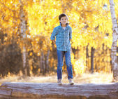 Autumn day, happy boy walking in the park — Stock Photo