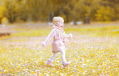 Positive child having fun in autumn day — Foto Stock