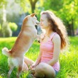 Dog and owner in park — Stock Photo #53777403
