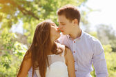 Sensual kiss young couple in summer day — Stock Photo